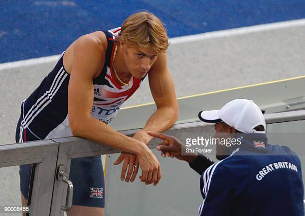 Christopher Tomlinson of Great Britain Northern Ireland talks to his coach in the men's Long Jump Final during day eight of the 12th IAAF World...