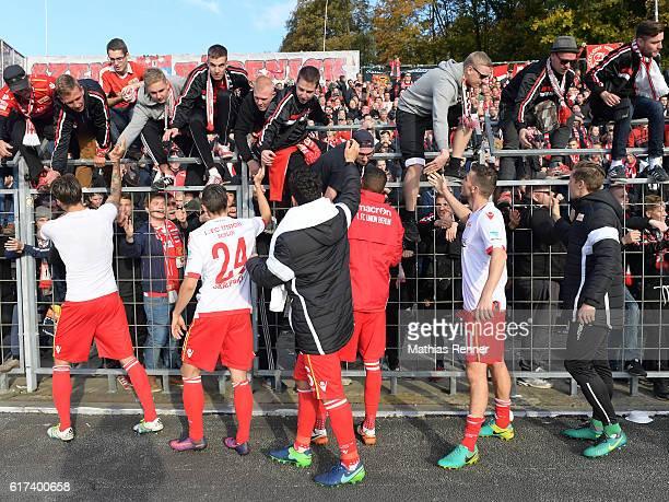 Christopher Trimmel Collin Quaner Steven Skrzybski Philipp Hosiner Dennis Daube and Daniel Mesenhoeler of 1 FC Union Berlin celebrate with the fans...