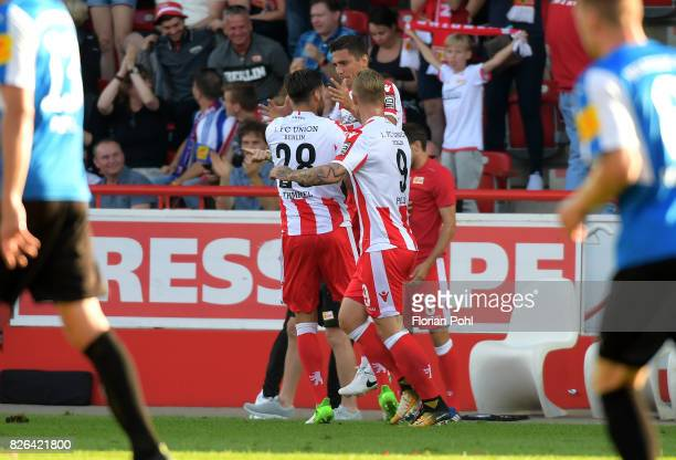 Christopher Trimmel Damir Kreilach and Sebastian Polter of 1FC Union Berlin celebrate after scoring the 11 during the game between Union Berlin and...