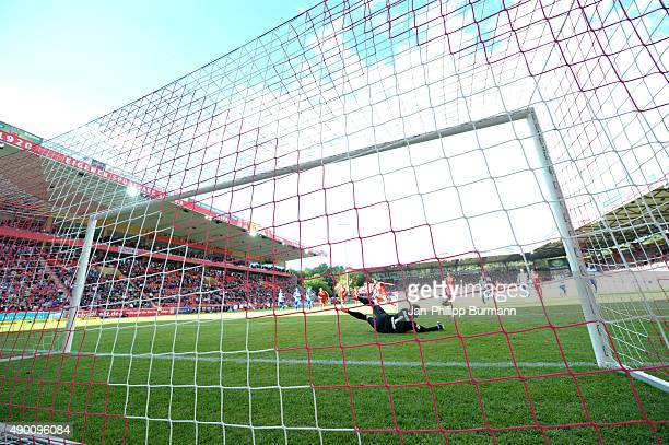 Christopher Trimmel of 1 FC Union Berlin shoots a penalty against Michael Ratajczak of MSV Duisburg during the game between Union Berlin and MSV...