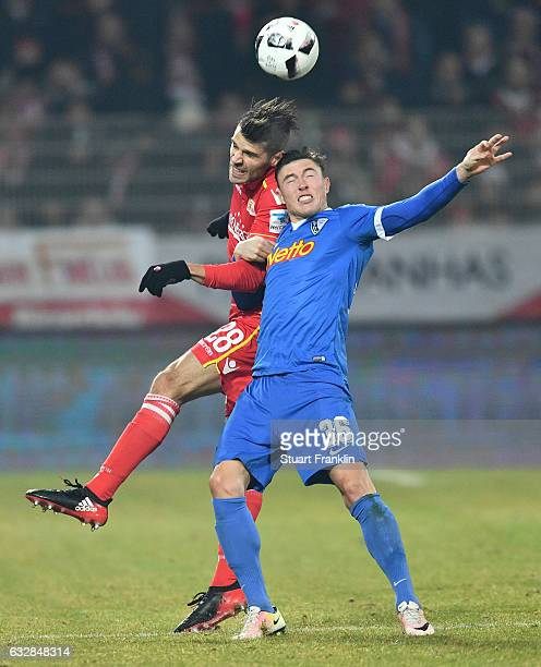 Christopher Trimmel of Berlin is challenged by Nils Quaschner of Bochum during the Second Bundesliga match between 1 FC Union Berlin and VfL Bochum...
