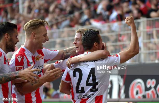 Christopher Trimmel Sebastian Polter Simon Hedlund and Steven Skrzybski of 1 FC Union Berlin celebrate after scoring the 32 during the game between...