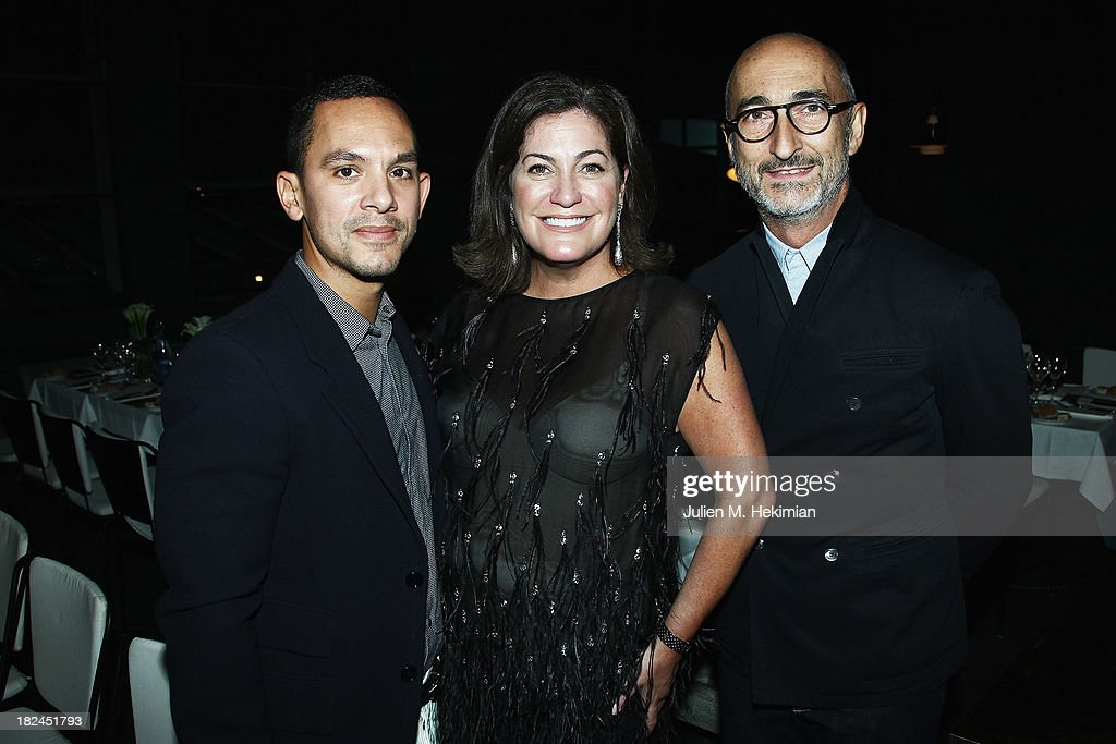 Christopher Turnier, Sasha Iglehart and Pierre Hardy attend the Glamour dinner for Patrick Demarchelier as part of the Paris Fashion Week Womenswear Spring/Summer 2014 at Monsieur Bleu restaurant on September 29, 2013 in Paris, France.