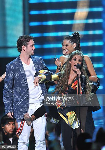 Christopher Uckermann and Anahi performs on stage at Univision's 2009 Premios Juventud Awards at Bank United Center on July 16 2009 in Coral Gables...