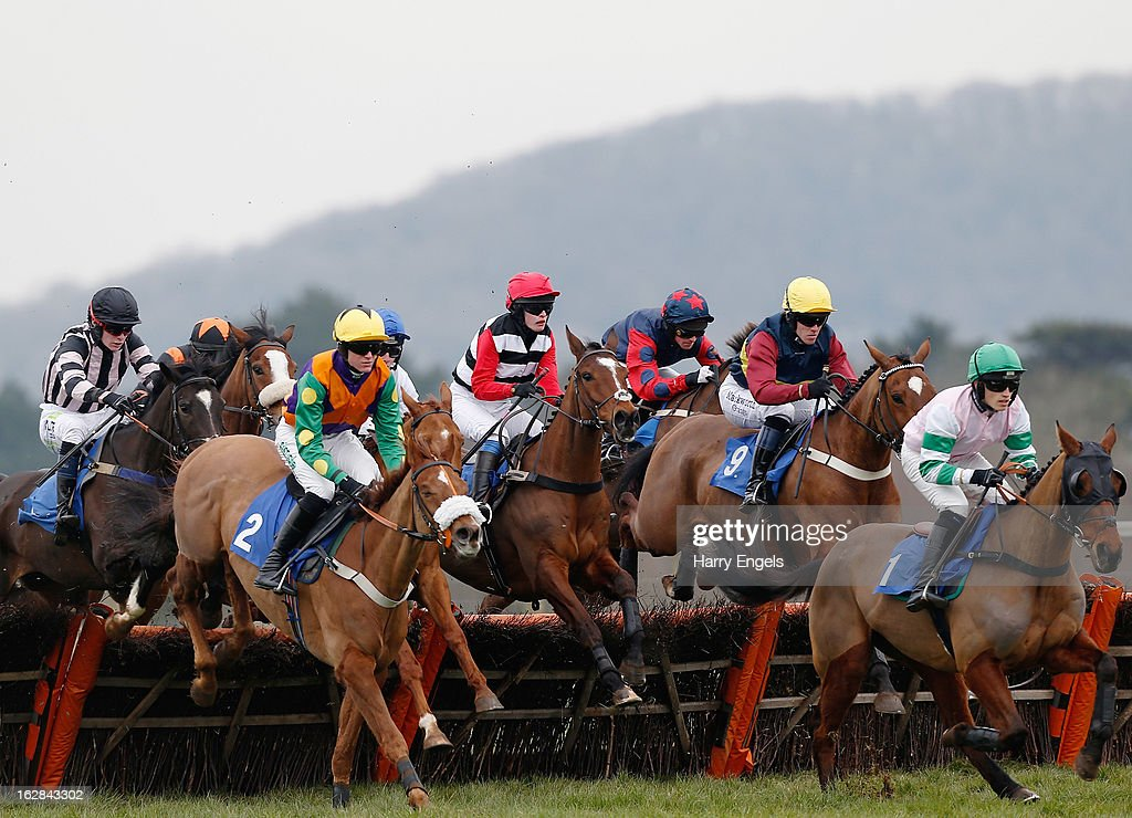 Christopher Ward riding Bellflower Boy (R) leads the pack over a hurdle during 'The Rural Living Show 23rd March Selling Hurdle Race' at Taunton Racecourse on February 28, 2013 in Taunton, England.