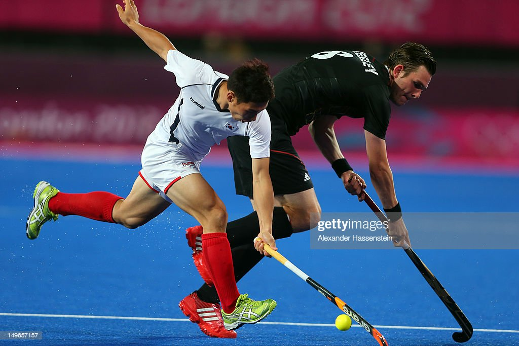 Christopher Wesley of Germany battles for the ball with Jongho Seo (L) of Korea during the Men's Hockey match between Korea and Germany on Day 5 of the London 2012 Olympic Games at the Riverbank Arena on August 1, 2012 in London, England.