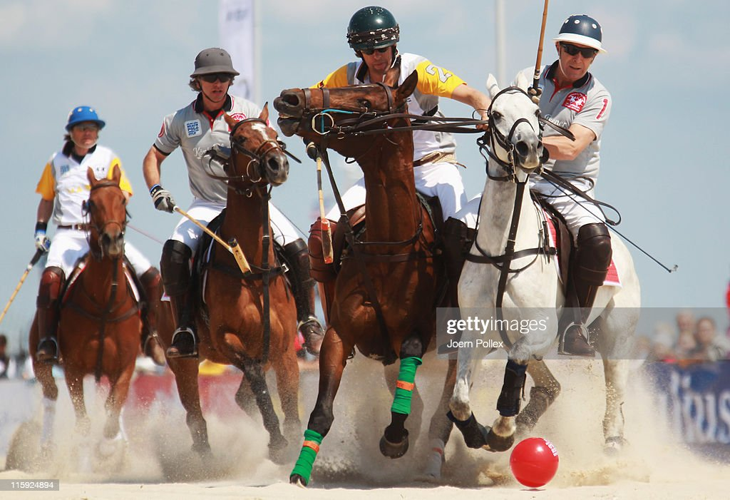 Christopher Winter (C) of team Koenig Pilsener and Philip Selkirk of team Maus Immobilien compete during the Julius Baer Beach Polo World Cup at Hoernum beach on June 12, 2011 in Hoernum, Germany.