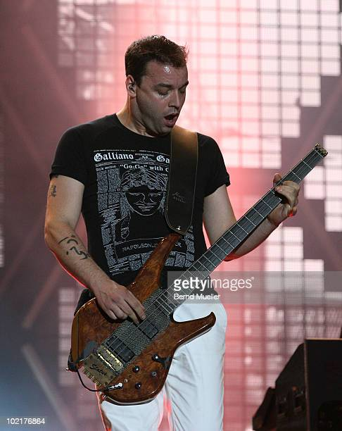 Christopher Wolstenholme of the band Muse performs on stage during the final day of Rock Im Park Festival at Zeppelinfeld on June 6 2010 in Nuremberg...