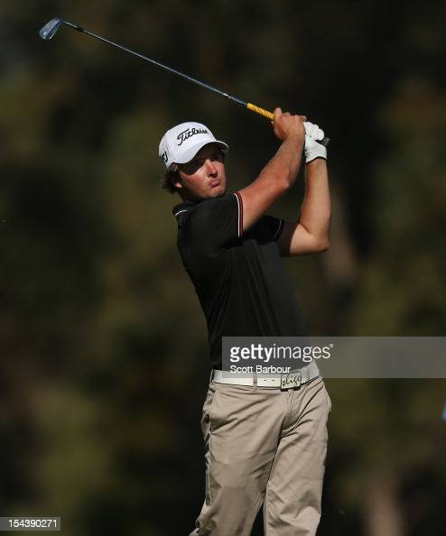 Christopher Wood of Queensland plays an approach shot on the 4th hole during day two of the Perth International at Lake Karrinyup Country Club on...