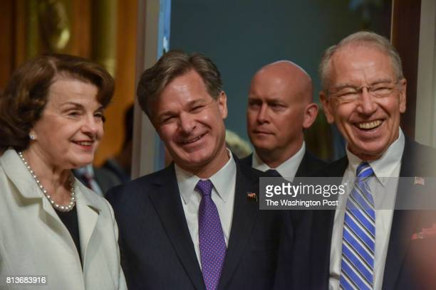 Christopher Wray 2nd from L is flanked by Senators Dianne Feinstein L and Chuck Grassley R enters the hearing room where he will face a confirmation...