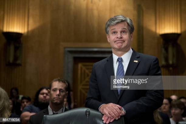 Christopher Wray director of the Federal Bureau of Investigation waits to begin a Senate Homeland Security Committee hearing in Washington DC US on...