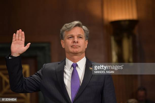 Christopher Wray takes the oath before testifying before the Senate Judiciary Committee on his nomination to be the director of the Federal Bureau of...