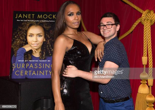 Christrian Siriano and Janet Mock pose infront of the cover of her new book during the 'Surpassing Certainty' Book release party at Public Hotel on...