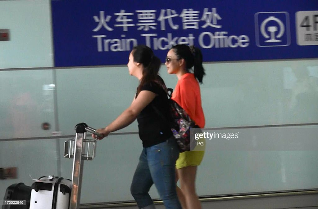 Christy Chung appeared in Beijing Airport in fashionable dress on Monday July 15,2013 in Beijing,China.