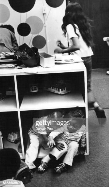 Christy Dyson 2 1/2 and Natasha Shafer use a toy storage children Credit Denver Post