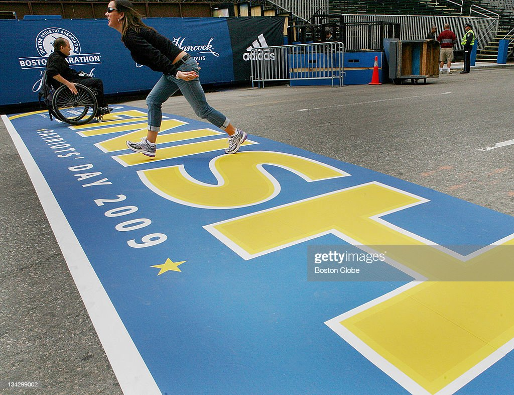 Christy Kopsidas of Washington DC poses for pictures on the finish line of the Boston Marathon in Copley Square Saturday April 18 2009 Kopsidas will...