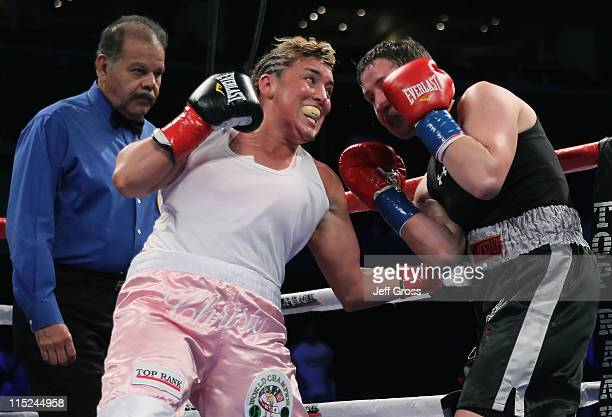 Christy Martin connects to the body of Dakota Stone as referee David Mendoza looks on during their welterweight bout at Staples Center on June 4 2011...
