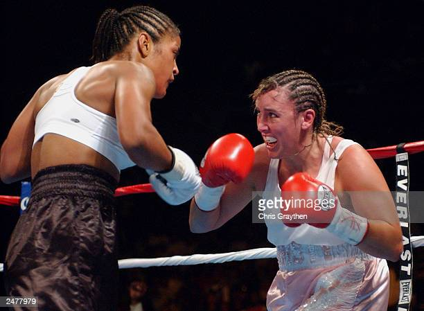 Christy Martin moves against Laila Ali on August 23 2003 at the Mississippi Coast Coliseum in Biloxi Mississippi Ali knocked out Martin in the fourth...