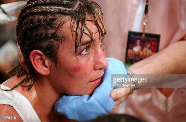 Christy Martin receives an ice pack to her chin while seated in her corner after being defeated by Laila Ali in the fourth round on August 23 2003 at...