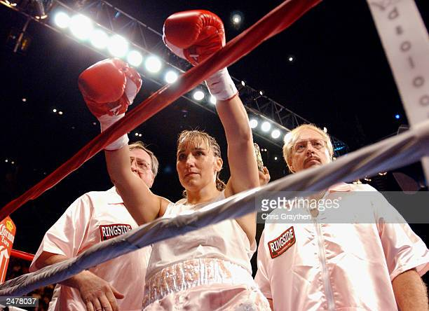Christy Martin salutes the crowd before her fight against Laili Ali on August 23 2003 at the Mississippi Coast Coliseum in Biloxi Mississippi Ali...