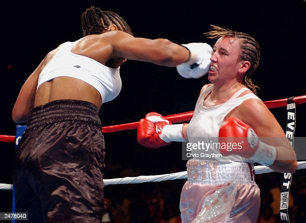 Christy Martin takes a lefthand punch to the face from Laila Ali on August 23 2003 at the Mississippi Coast Coliseum in Biloxi Mississippi Ali...