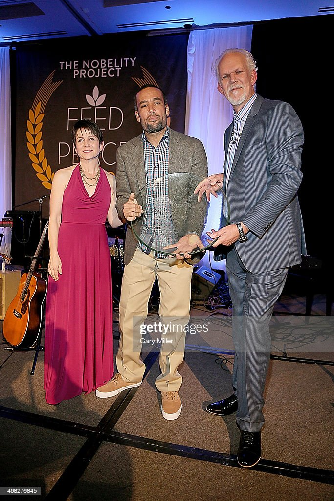 Christy Pipkin Ben Harper and Turk Pipkin pose on stage after Ben receives the Willie Nelson Feed The Peace Award from the Nobelity Project at the...