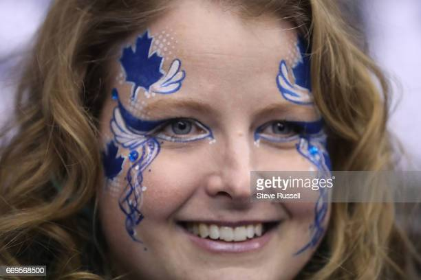 TORONTO ON APRIL 17 Christy Smith waits for the game to start Toronto Maple Leaf fans cheer before the Toronto Maple Leafs play the Washington...