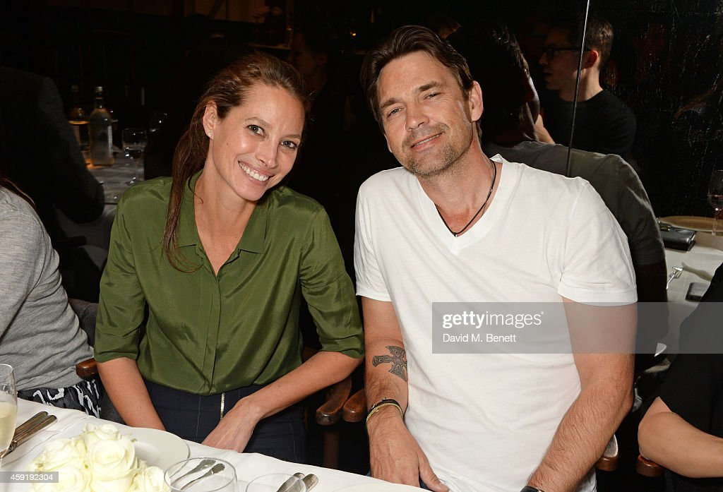 Christy Turlington Burns (L) and Dougray Scott attend a dinner hosted by PORTER in honour of cover girl Christy Turlington Burns and her charity Every Mother Counts at Mr Chow on November 18, 2014 in London, England.