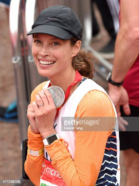 Christy Turlington Burns poses with her medal after completing the London Marathon on April 26 2015 in London England