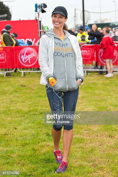 Christy Turlington poses for photographs at the celebrity start at The London Marathon 2015 on April 26 2015 in London England