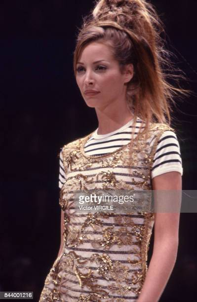 Christy Turlington walks the runway at the Jean Paul Gaultier Ready to Wear Spring/Summer 1993 fashion show during the Paris Fashion Week in October...