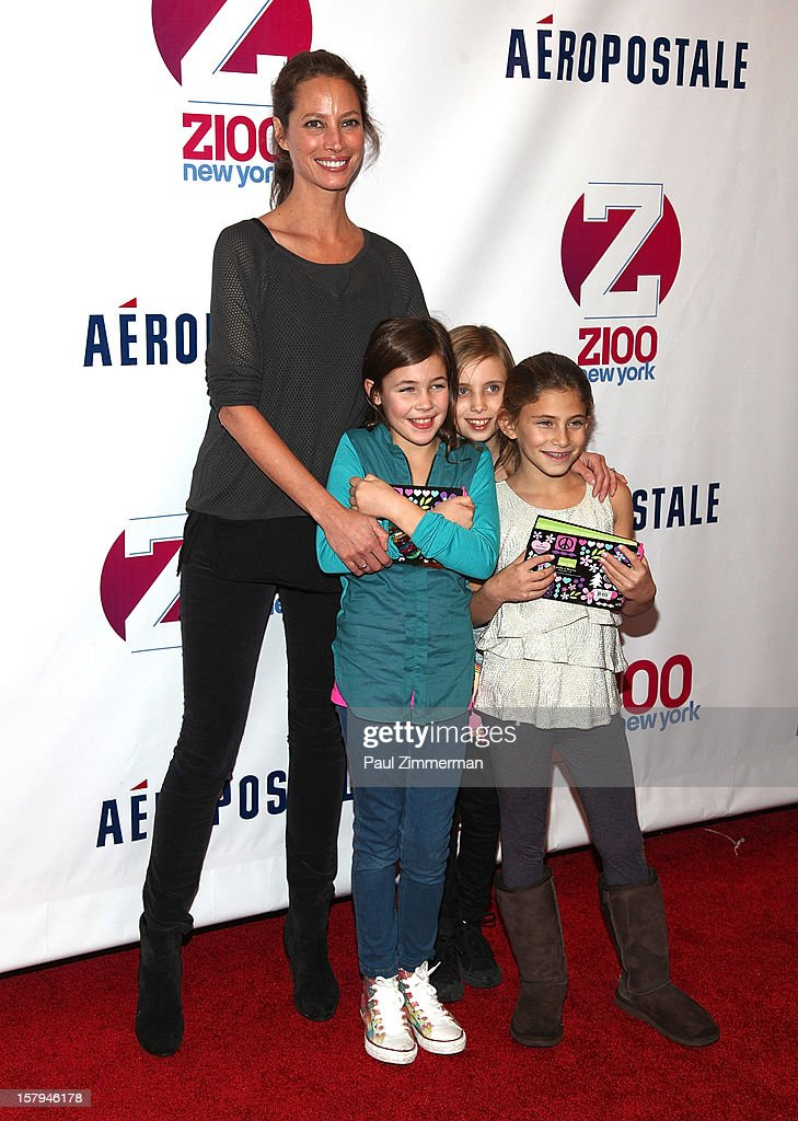<a gi-track='captionPersonalityLinkClicked' href=/galleries/search?phrase=Christy+Turlington&family=editorial&specificpeople=207046 ng-click='$event.stopPropagation()'>Christy Turlington</a> with daughter, Grace Burns (L) and friends attend Z100's Jingle Ball 2012 presented by Aeropostale at Madison Square Garden on December 7, 2012 in New York City.