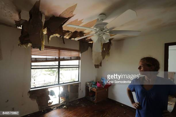 Christy Velasquez surveys the damage to her home done by Hurricane Irma on Big Pine Key September 13 2017 in Big Pine Key FloridaVelasquez's husband...