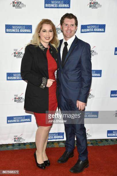 Christy WalkerWatkins of The ArtistoMedia Group and guest arrives at the 2017 Nashville Business Journal Women In Music City on October 17 2017 in...