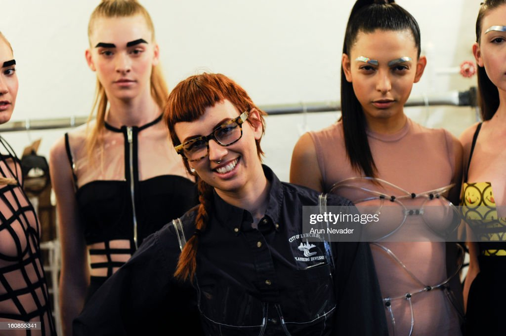Chromat designer Becca McCharen poses with models backstage at the Chromat Fall 2013 Presentation during Mercedes-Benz Fashion Week at Industria Superstudio on February 6, 2013 in New York City.