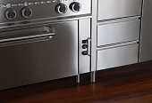 Chromatic kitchen oven and drawers detail