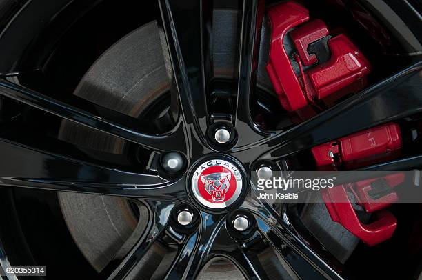 A chrome and red Jaguar logo badge within a black alloy wheel on October 20 2016 in Southend United Kingdom