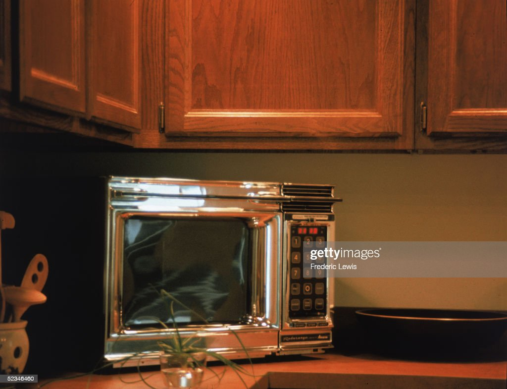 A Chrome Radarange By Amana Microwave Oven Features Keypad And Digital Display Screen Sits