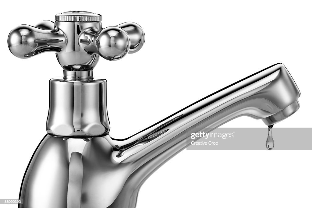 Chrome tap / faucet with water dripping from it : Stock Photo