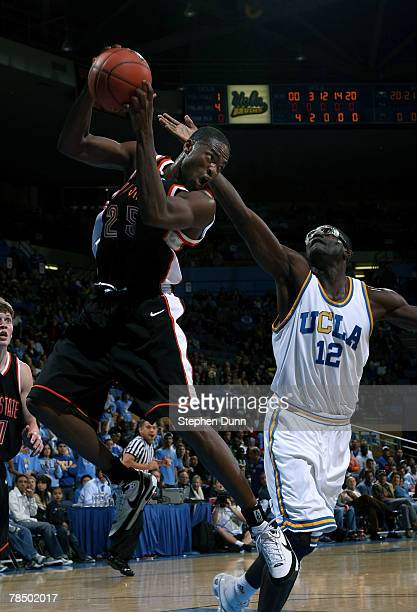 Chron Tatum of the Idaho State Bengals grabs a rebound in front of Alfred Aboya of the UCLA Bruins on December 15 2007 at Pauley Pavillion in...