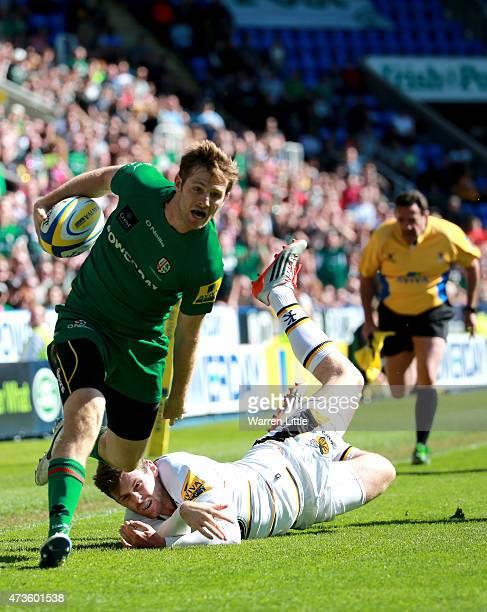 Chros Noaks of London Irish scores a try during the Aviva Premiership match between London Irish and London Wasps at Madejski Stadium on May 16 2015...