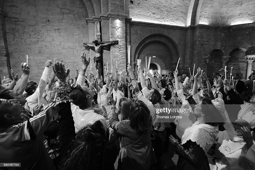 Chruch members and gypsies sing and pray while the casket with the reliquary of the local saintes Mary Salome and Mary Jacobe is lifted on May 25, 2016 in Saintes-Maries-de-la-Mer near Arles, France. Gypsies from all over Europe worship 'Sara the Black', their Saint and patroness, for one week. Sara's statue is situated in the crypt of the church.