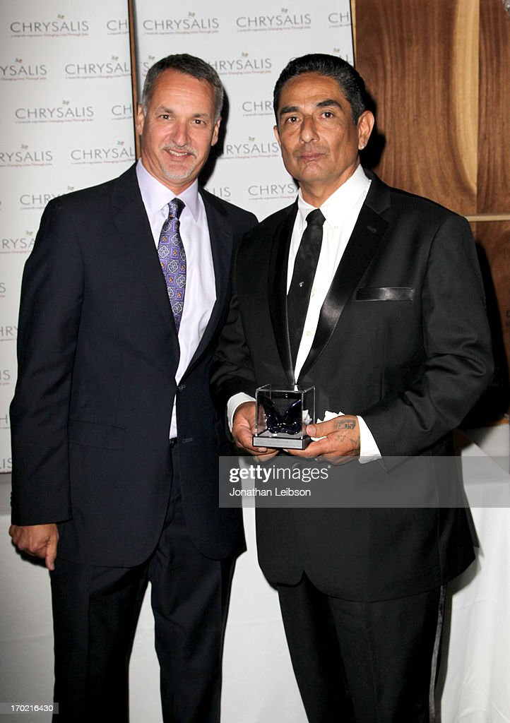 Chrysalis President & CEO Mark Loranger (L) and Johnny Gutierrez, recipient of the John Dillon Award attend the 12th Annual Chrysalis Butterfly Ball on June 8, 2013 in Los Angeles, California.