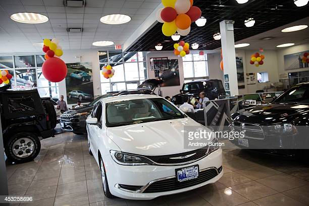 Chrysler 200 is displayed on a showroom floor on August 6 2014 in New York City Chrysler Group LLC's profit gained 22% in the second quarter...