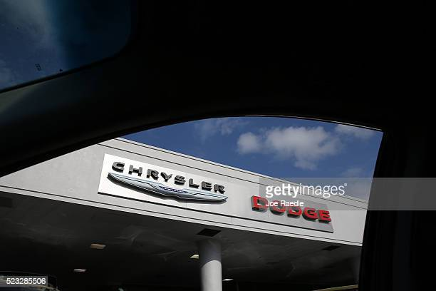 Chrysler and Dodge sign is seen on a dealership as Fiat Chrysler Automobiles announced that it is recalling more than 11 million cars and SUVs...
