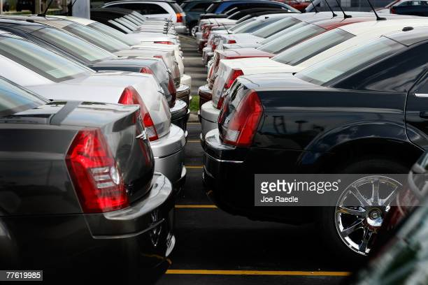 Chrysler automobiles are seen for sale on the new car sales lot at the Potamkin Chrysler Jeep auto dealership November 1 2007 in Miami FLorida In the...