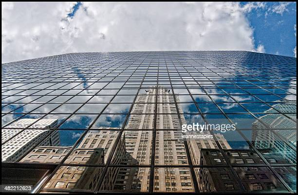 Chrysler building and skyscraper reflections in glass building, New York, america, USA