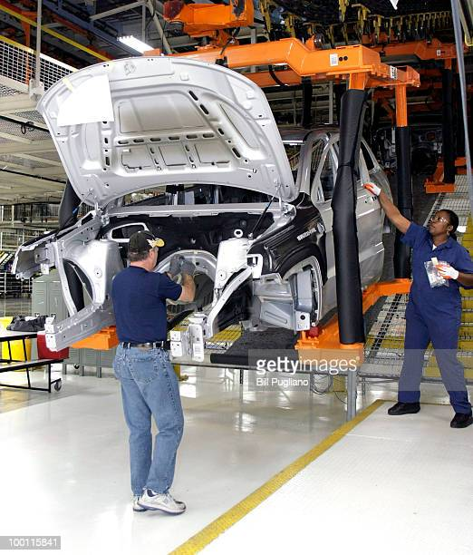Chrysler employee works on the assembly line making the new Jeep Grand Cherokee at the Chrysler Jefferson Avenue Plant May 21 2010 in Detroit...