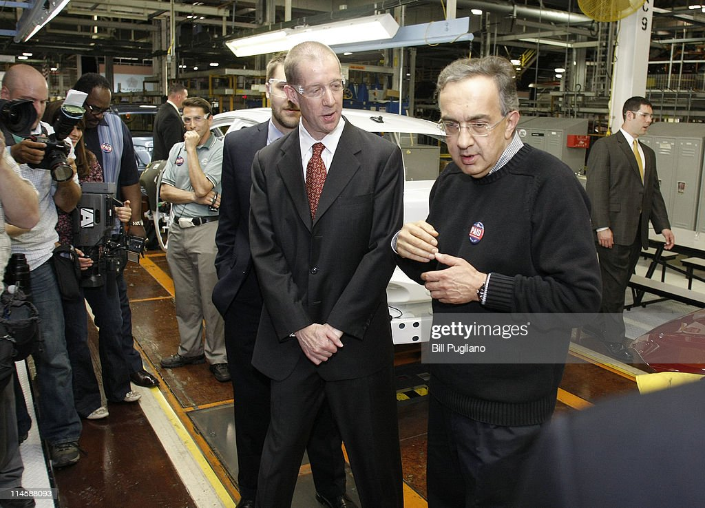 Chrysler Group and Fiat SpA CEO <a gi-track='captionPersonalityLinkClicked' href=/galleries/search?phrase=Sergio+Marchionne&family=editorial&specificpeople=608333 ng-click='$event.stopPropagation()'>Sergio Marchionne</a> (R) leads a tour with Ron Bloom (L) Assistant to President Barack Obama for Manufacturing Policy, before the announcement of the repayment of the remaining $5.9 billion of Chrysler's $10.5 billion loan from the U.S. Government at the Sterling Heights Assembly Plant May 24, 2011 in Sterling Heights, Michigan. Chrysler Group is also retiring a $1.7 billion loan it received from the Canadian government.