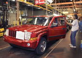 Chrysler Group assembly tech Angela Baber of Detroit MIchigan works on the allnew 2006 Jeep Commander at the DaimlerChrysler Jefferson North Assembly...